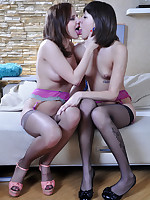 Two girls in dark stockings and pink garters enjoy wet lesbian slit licking