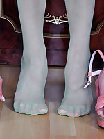 Trendy chick shows off high arc feet in green tights and various high heels