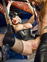 Two girls and a guy have hot threesome in leather