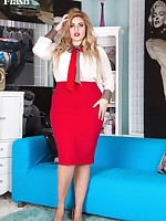 Curvy Ellie posing in her air hostess uniform with seamed ff nylons and red heels!