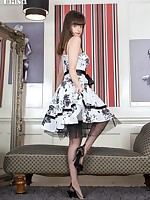 Kate Anne is thrilled to be in a nice full skirted frock, and heels with a VERY raunchy girdle on taut with her seamed black fully fashioned nylons.