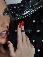 Paige loves to take a slow drag on a cigarette and seductively blow the smoke out.